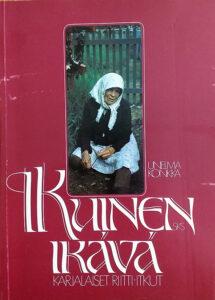 Punakantinen kirja jossa lukee Ikuinen ikävä, karjalaiset riitti-itkut ja kuvassa nainen huivissa ja mekossa on polvillaan.